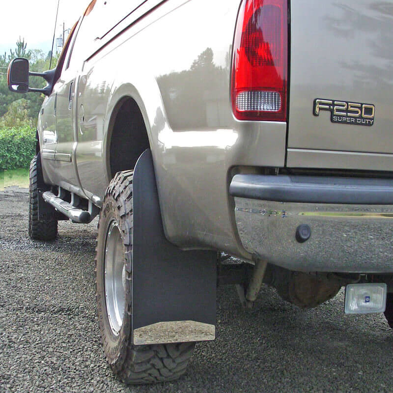 """Mud Flaps on 2003 Ford F-250 with lift and oversized, offset tires using 14"""" wide Front Lifted Truck Brackets and 14"""" wide Extra Long Rear Drill-Less Installation with Custom Shift 1"""" Outwards"""